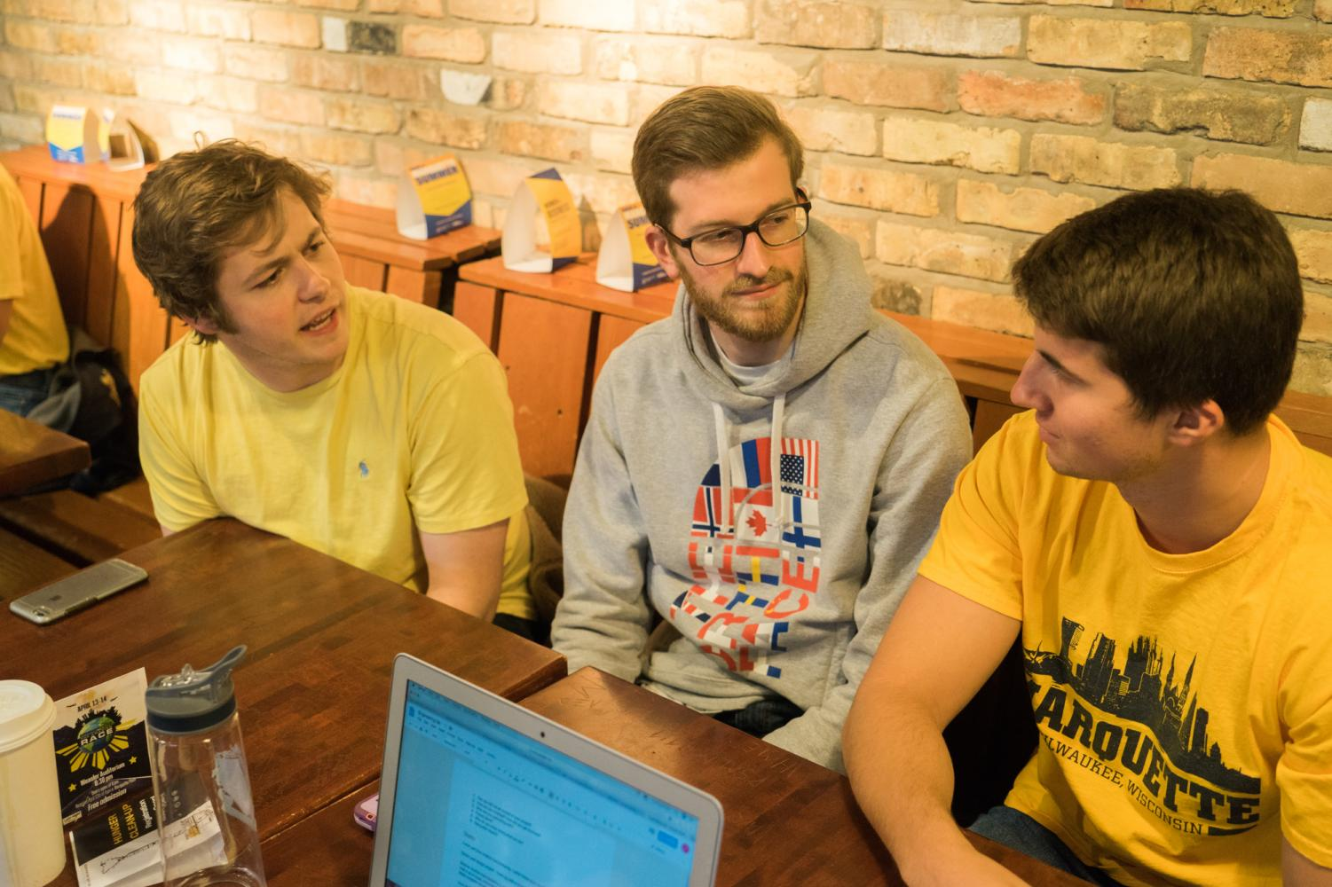 From left to right, engineering students TImothy Fair, Sam Goulet and Shaun Plunkett discuss their senior design project.