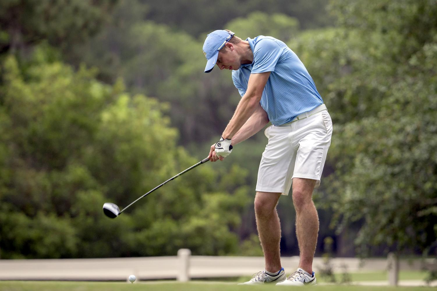 Marquette golfer Oliver Farrell prepares to hit a drive at the BIG EAST championships in Okatie, South Carolina. (Photo courtesy of Marquette Athletics.)