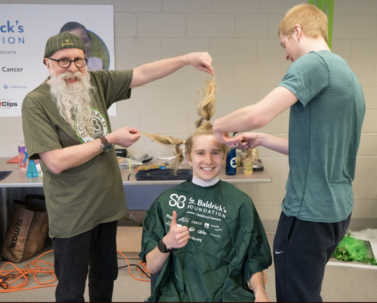 Freshman Joseph Miscimarra poses before he gets his head shaved for the St. Baldrick's Foundation April 21.