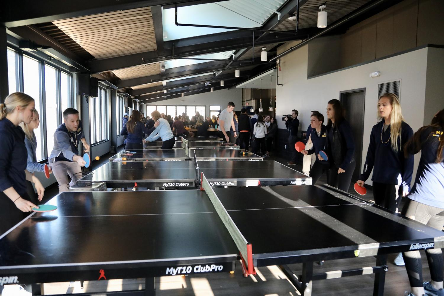 Women's lacrosse carried over their staff games of pingpong from the office to Evolution: Milwaukee.