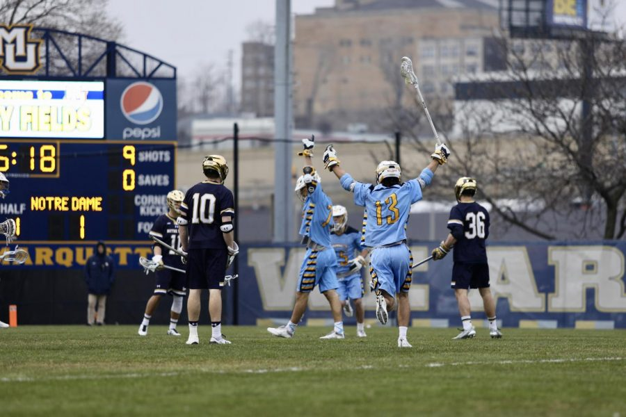Connor McClelland celebrates with teammate John Wagner after a goal in the first half against Notre Dame. Marquette plays Providence Saturday afternoon.