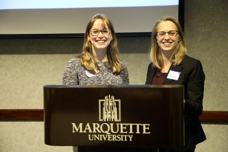 Kaitlyn Daly (left) and Caroline Redick pose at the symposium.