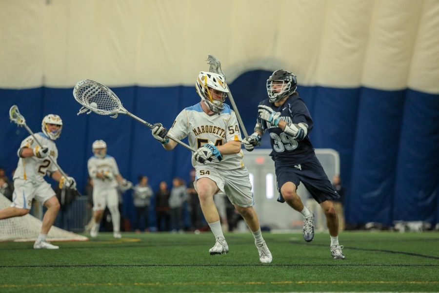 Senior+goalie+Cole+Blazer+made+14+saves+in+a+7-4+loss+to+Denver+last+Saturday.+Marquette+will+look+to+win+the+BIG+EAST+Tournament+for+the+third+straight+season+%28Photo+courtesy%3A+Marquette+Athletics%29.