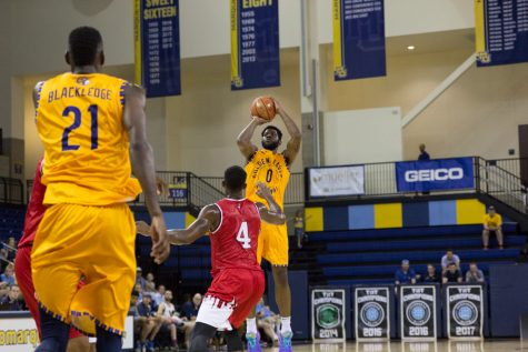 Golden Eagles survive late Harvard comeback, prevail in opening NIT game