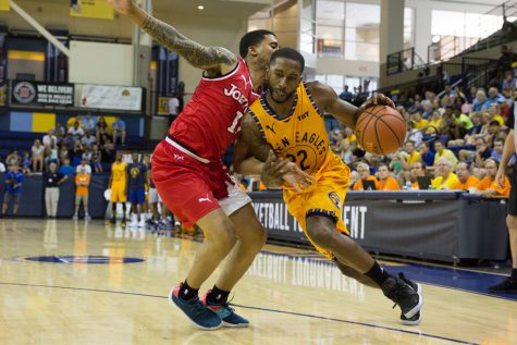Hot shooting from Wilson helps Golden Eagles Alumni avoid early upset