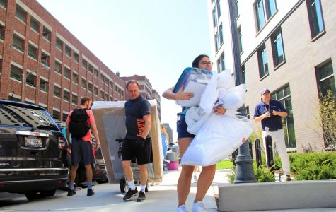 Students and their parents carry in dorm room furniture late Thursday morning.