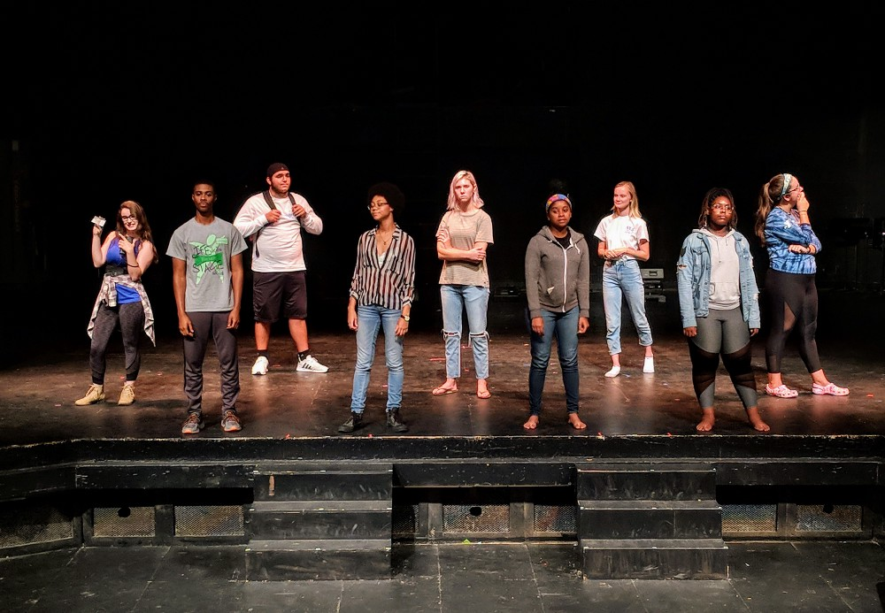 Students acting in the play, White Privilege,  stand together as part of a scene.   Photo courtesy of Cambry Getter