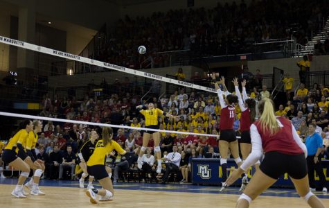 Senior outside hitter Anna Haak goes for a kill against No. 6 Wisconsin Friday night at the Al McGuire Center.