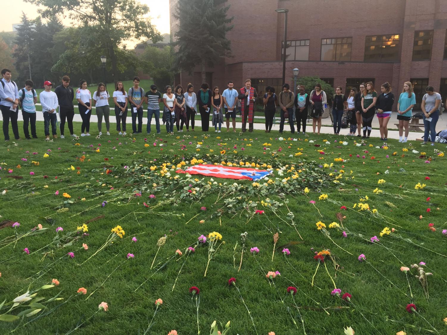Students gather around a Puerto Rican flag outside the AMU to share stories and pray for those affected by Hurricane Maria.