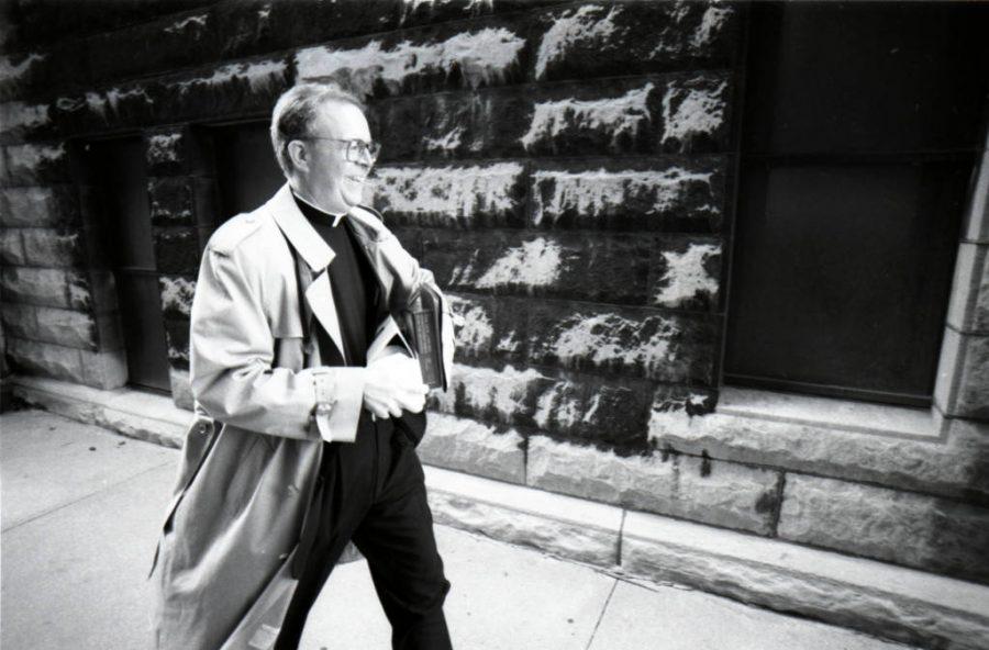 Rev.+Robert+A.+Wild%2C+S.J.%2C+walks+across+campus+between+inaugural+events%2C+November+1996.+Via+Marquette+University+Library+Archives.