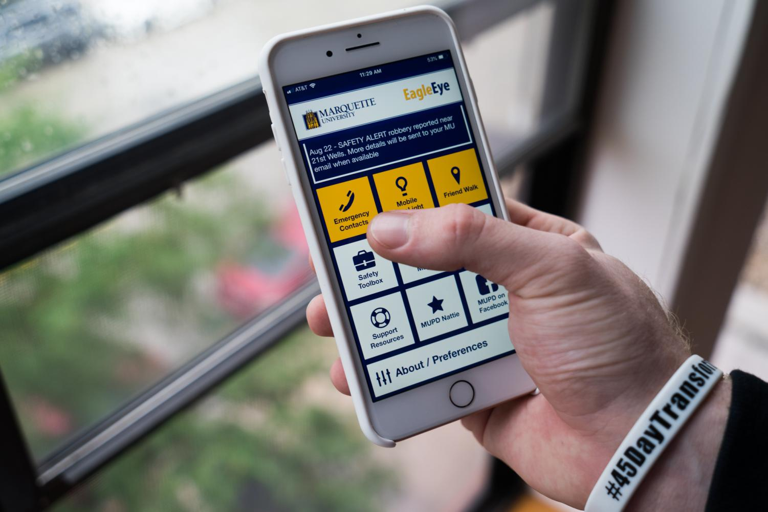 Student uses MUPD's  safety app, EagleEye.