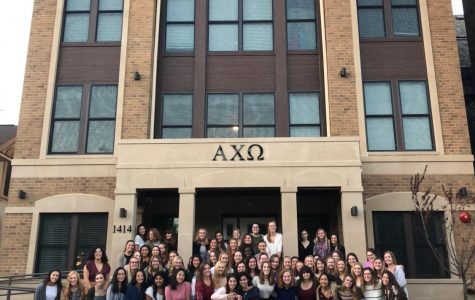 Sisters of Alpha Chi Omega Theta Omega Chapter stand before their new house.  Photo courtesy of Kathryn McCarthy.