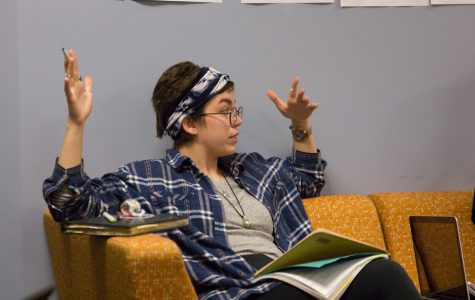Hannah Badeau, a senior in the College of Arts & Sciences, talks with students during a Sept. 27 meeting in the AMU.