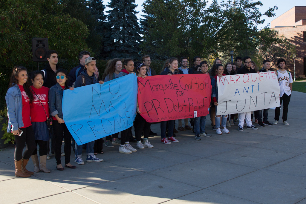 Students gather outside of the Alumni Memorial Union to pass a petition to support the Marquette Puerto Rican Coalition Debt relief.