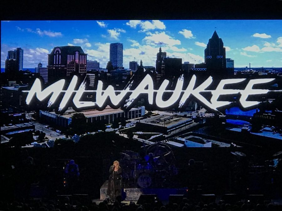 Front woman Stevie Nicks stands in front of a Milwaukee sign during the concert.