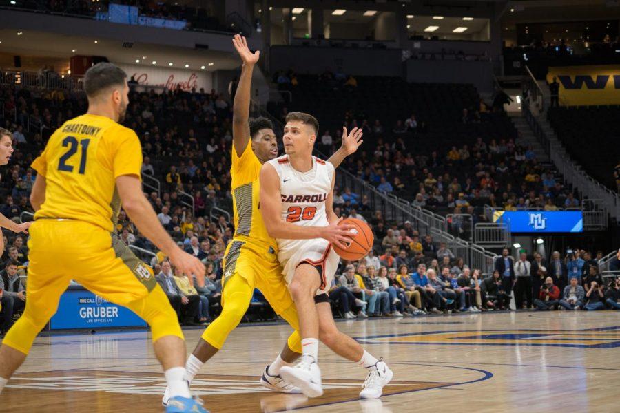 Men's basketball eases past Carroll University in exhibition despite poor perimeter shooting