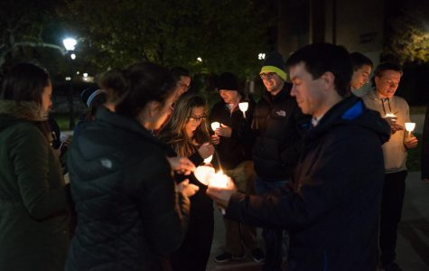Individuals attended a candlelight vigil in solidarity of respect life month.