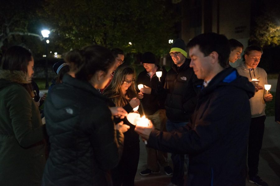 Individuals+attended+a+candlelight+vigil+in+solidarity+of+respect+life+month.+