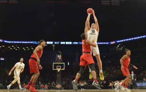 Late heroics from Joey Hauser gives Marquette quality win over Louisville