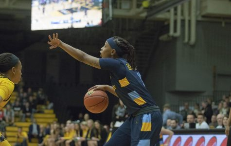 Women's basketball sneaks past crosstown rival UWM