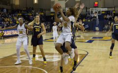 Women's basketball survives late scare against Michigan