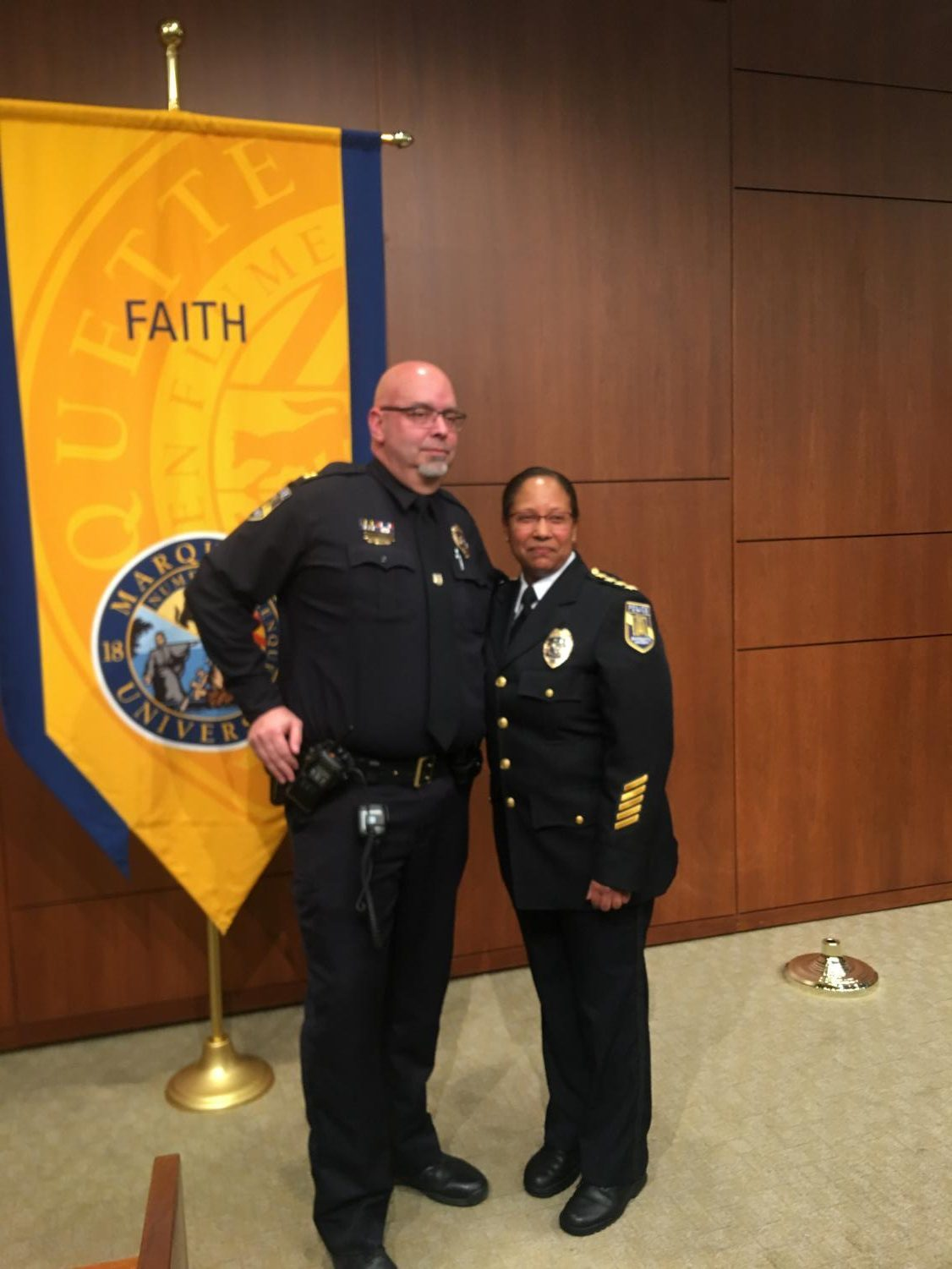 Former interim chief Capt. Jeff Kranz (left) poses for a photo with Chief Edith Hudson, who was sworn in Monday afternoon.