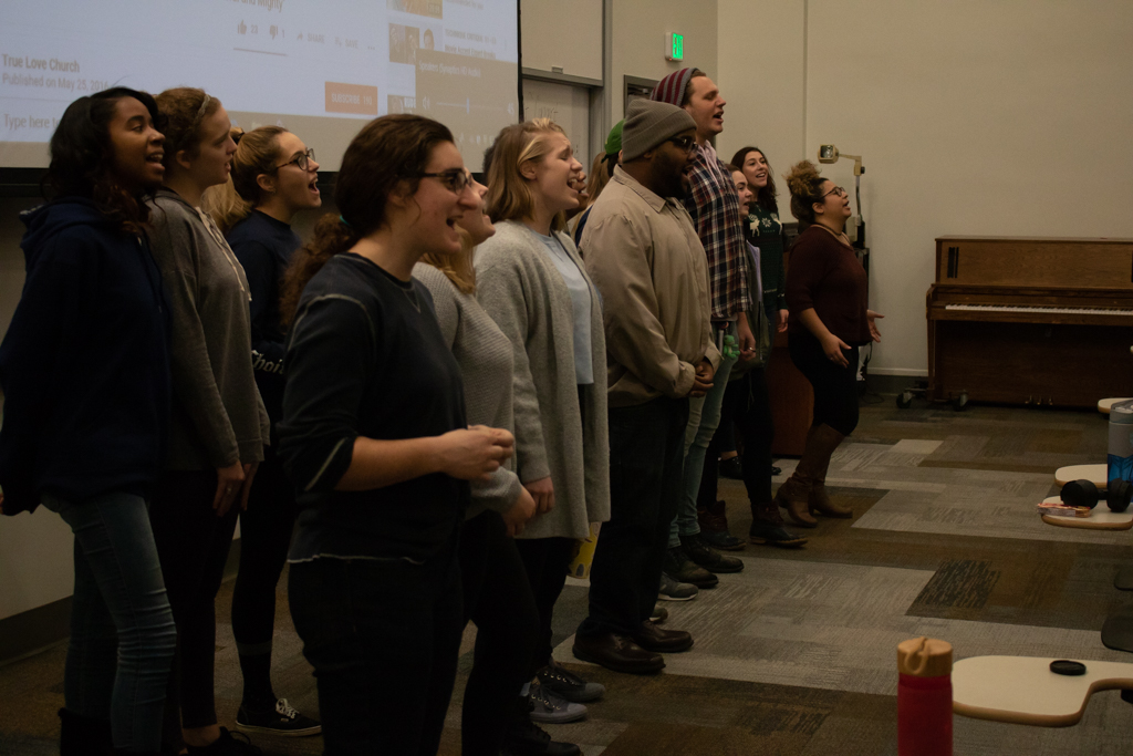 Marquette's Gospel Choir rehearses for their Christmas Concert which will be held at Weasler Auditorium Friday.