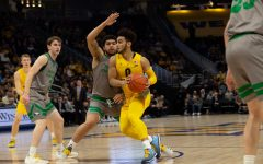 Marquette eases past North Dakota with Howard's 26-point performance