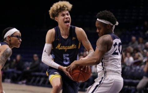 Early 19-0 run helps Marquette ease past Xavier with historic milestone