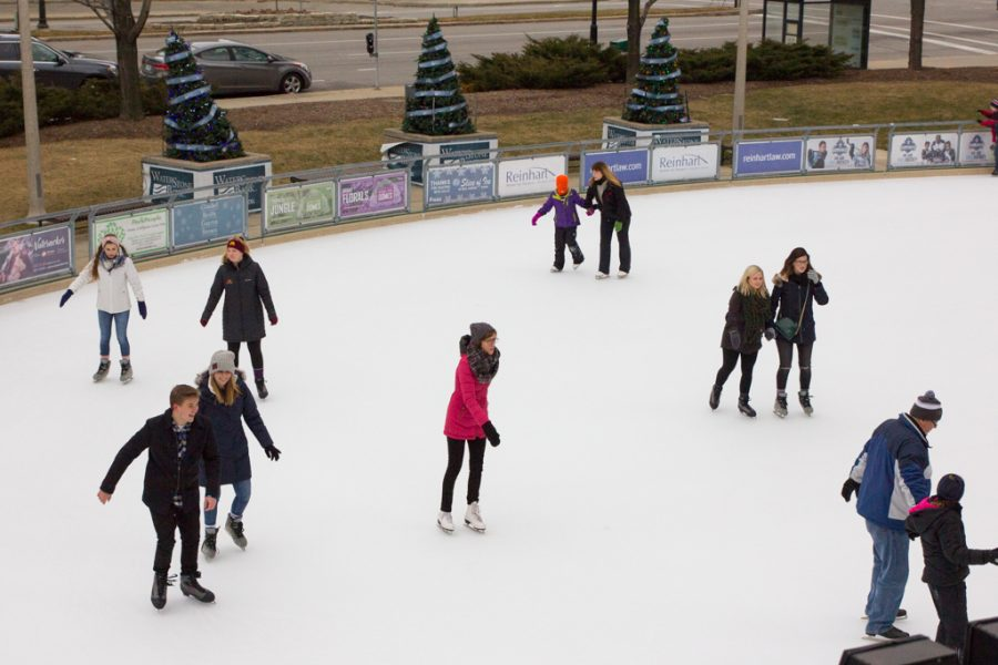 Skaters+of+various+ages+enjoy+Red+Arrow+Park%27s+Slice+of+Ice%2C+an+ice+rink+located+in+downtown+Milwaukee+with+free+admission+and+%249+skate+rentals.+