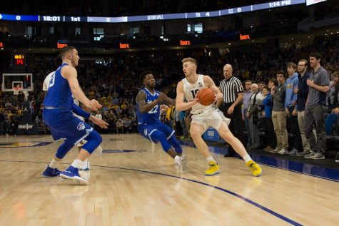 Howard breaks own record in No. 21 Marquette's 106-104 overtime win over Creighton