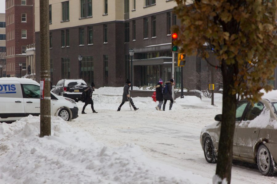 Students trek through the snow on the first day of cancelled classes in five years.