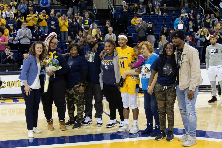 Blockton with her family and head coach Carolyn Kieger after the Golden Eagles' 79-53 victory over Xavier.