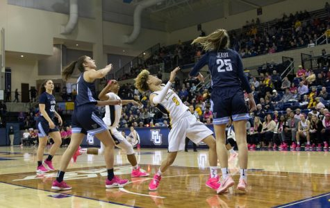 Improved defense helps No. 8 Marquette