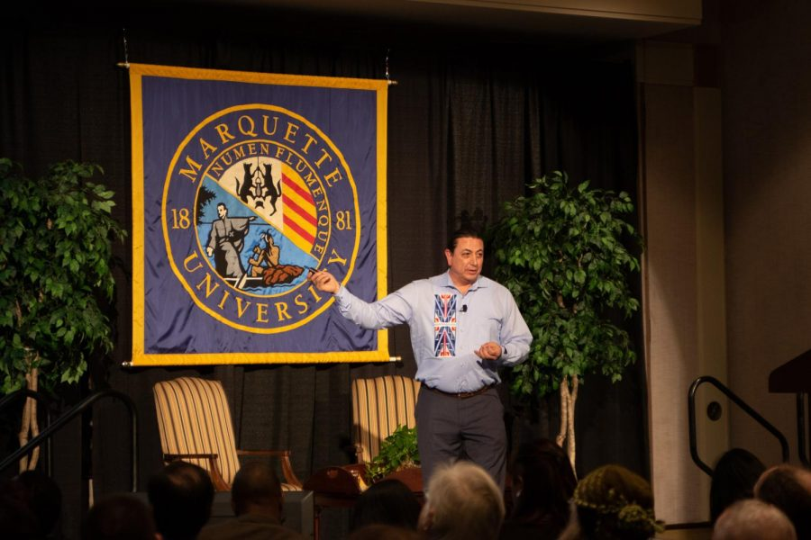 David Archambault speaks to a Marquette audience about the history of Native Americans and their land