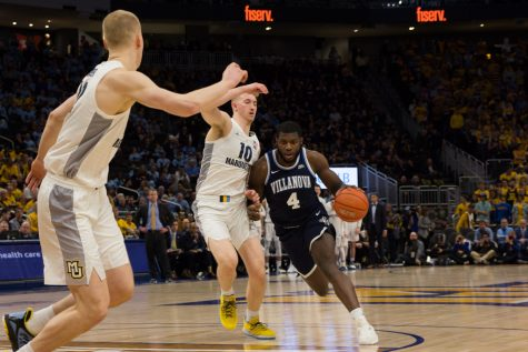 Howard scores 23 in BIG EAST debut as MU outlasts Georgetown
