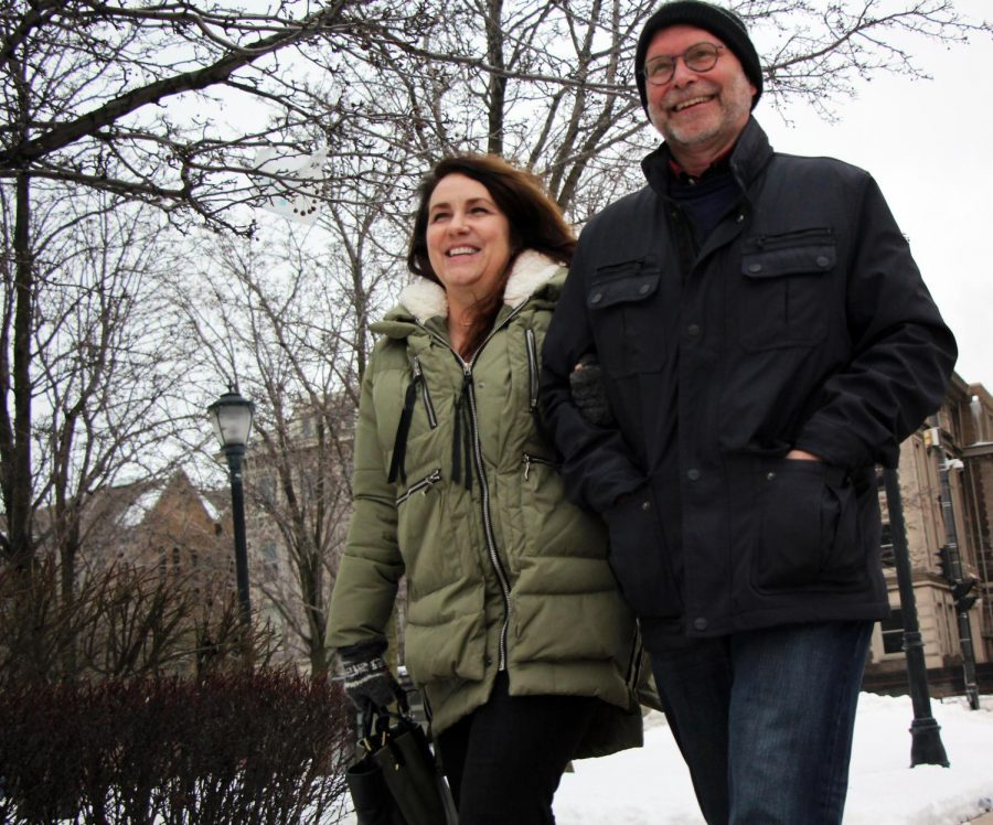 Jane Panther (left) walks arm-in-arm with her husband Rob Panther.