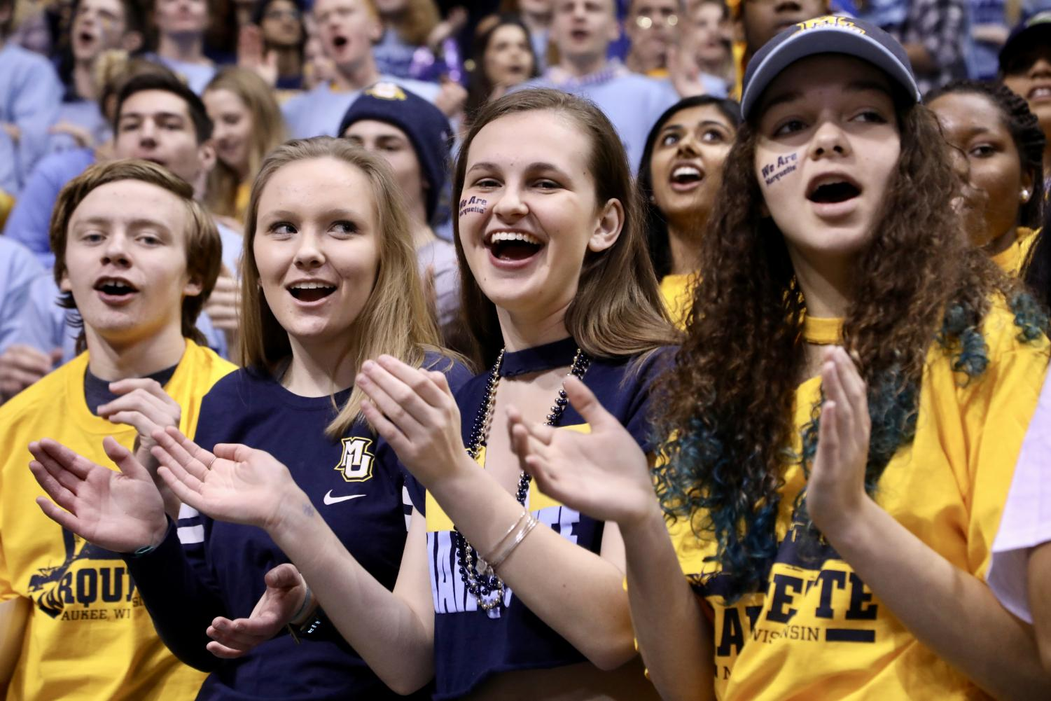 Students cheer in the stands of the Bradley Center at the Men's Basketball game on National Marquette Day 2018.
