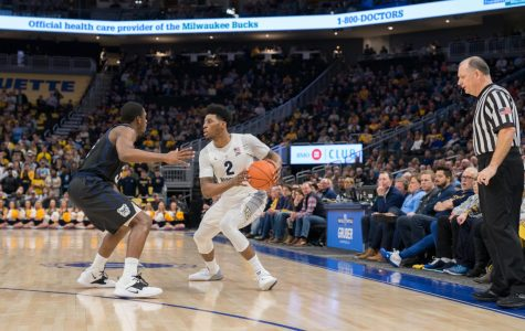 No. 11 Marquette wins on road despite lack of productivity from Howard