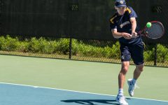 Men's tennis struggles in double play, on the road