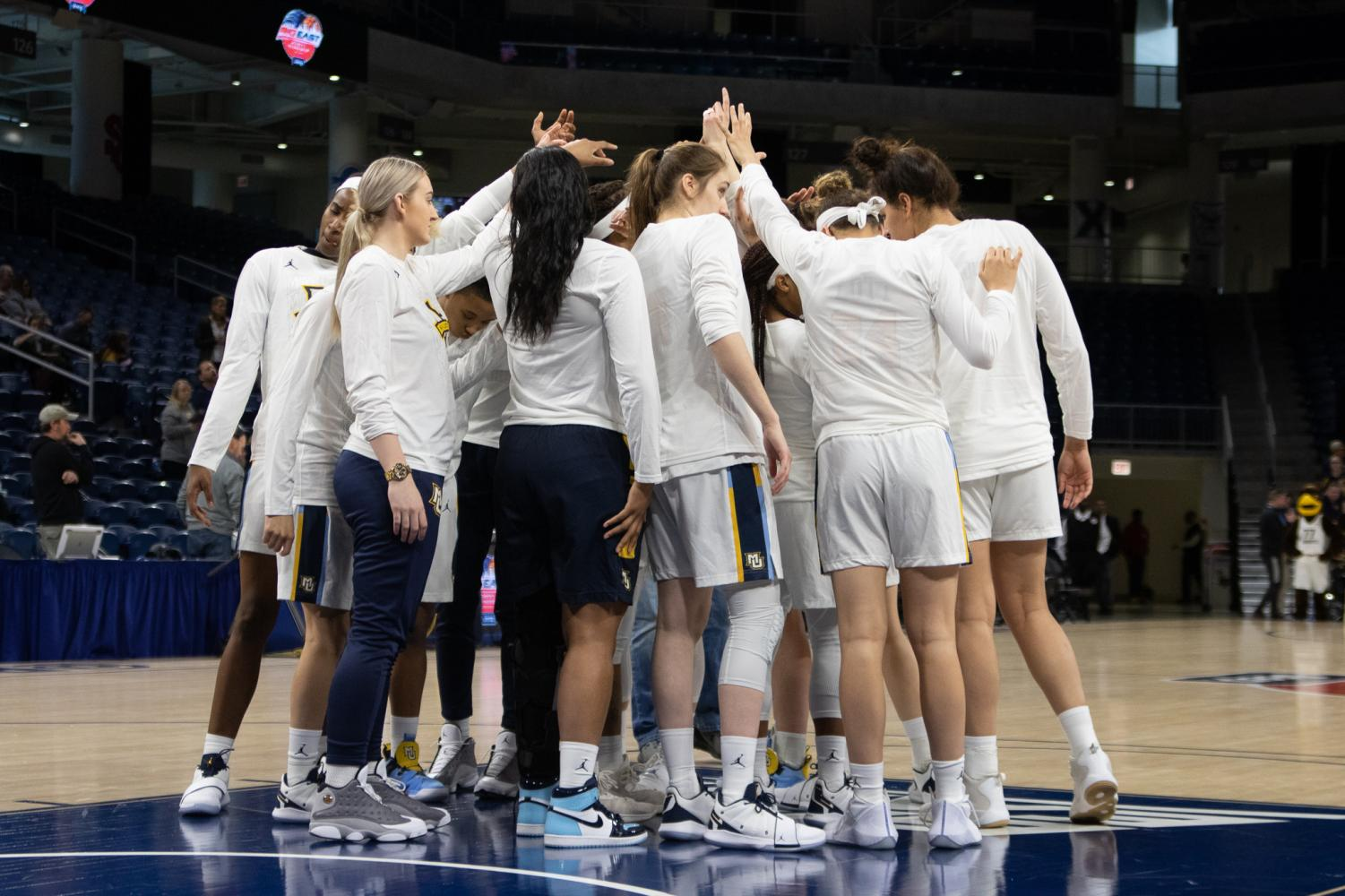 Marquette+women%27s+basketball+huddles+in+the+2019+BIG+EAST+Quarterfinals.