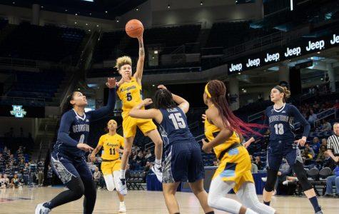 Natisha Hiedeman elevates against the Georgetown defense in the BIG EAST Semifinals.