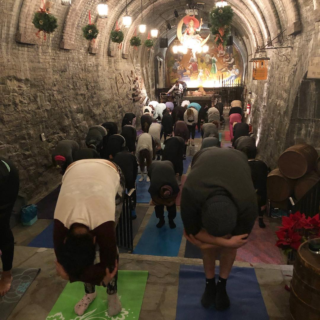 MKE Yoga Events has yoga sessions in non-traditional settings such as breweries, distilleries and even the Historic Miller Caves.  Photo courtesy of MKE Yoga Events