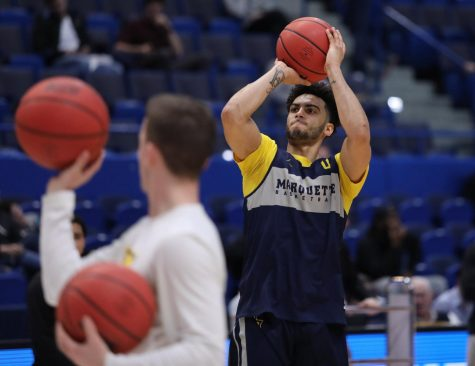 King scores 1000th point in Marquette's blowout over Montana State