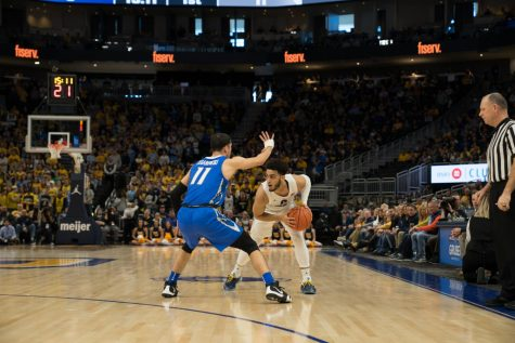 Howard's scoring helps No. 23 Marquette go to first BIG EAST semifinal in Wojo era