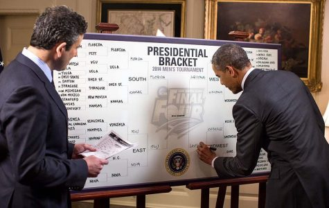 President Barack Obama participates in an ESPN interview with Andy Katz regarding the President's 2014 NCAA Division I Men's Basketball Tournament bracket, in the Map Room of the White House, March 18, 2014. (Official White House Photo by Pete Souza)