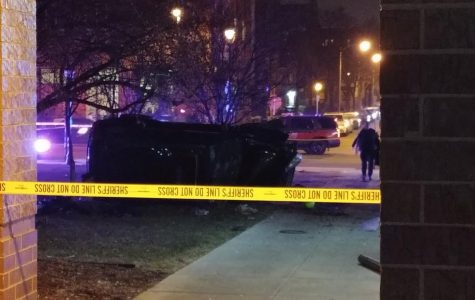 A car appeared to be flipped on its side after crashing near the Alumni Memorial Union.