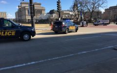 Car flipped in intersection near Straz Tower
