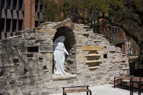 Marian grotto under construction behind St. Joan of Arc Chapel
