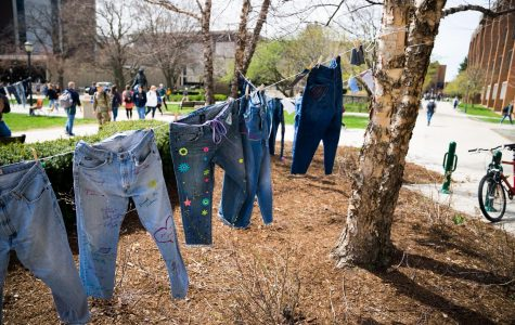 Pairs of jeans, donated and decorated by students, re  in central mall for Denim Day.